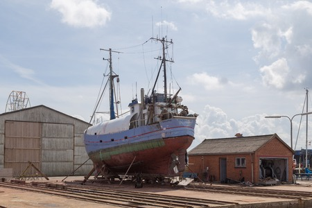 drydock: Hundested, Denmark - July 11, 2016: A boat in the dry dock.