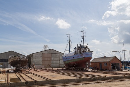 drydock: Hundested, Denmark - July 11, 2016: Boats in the dry dock. Editorial