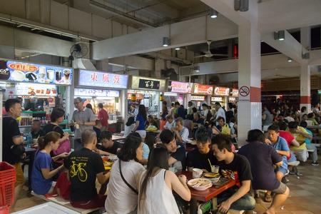 Singapore, Singapore - January 31, 2015: People enjoying food at the Lau Pa Sat foodcourt .