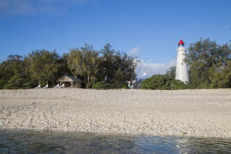 pristine coral reef: A beach and a lighthouse on Lady Elliot Island in Queensland, Australia Stock Photo