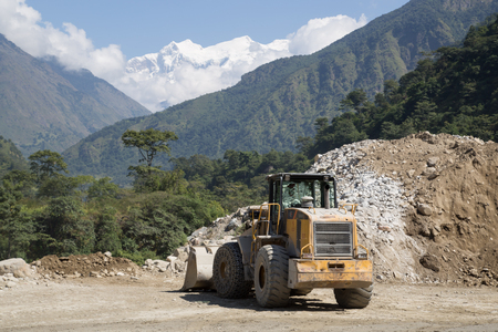 wheel loader: Bhulbhule, Nepal - October 23: A wheel loader on the hydropower plant construction site in the Annapurna Region