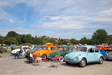 meetup: Celle, Germany - August 7, 2016: People and several Volkswagen Kaefer at the annual Kaefer Meeting