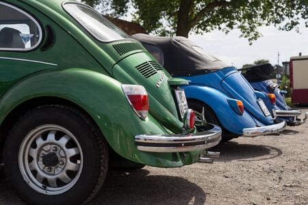 meetup: Celle, Germany - August 7, 2016: Detail view of three Volkswagen Kaefer at the annual Kaefer Meeting