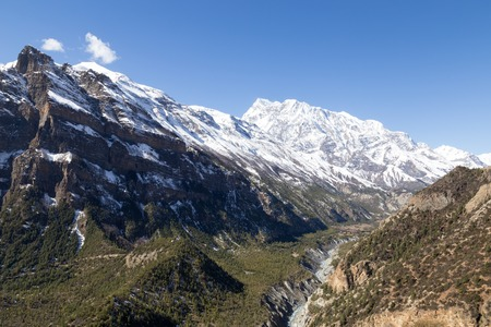 moutains: Mountain landscape with snow capped moutains on the Annapurna Circuit in Nepal