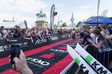 Copenhagen, Denmark - August 21, 2016: Triathlete Will Clarke just before crossing the finish line as 2nd in mens at the KMD Ironman Copenhagen 2016 in 07:59:31 Editorial