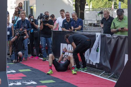 patrik: Copenhagen, Denmark - August 21, 2016: An exhausted Will Clarke who finished as 2nd in mens at the KMD Ironman Copenhagen 2016 in 07:59:31