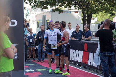 congratulating: Copenhagen, Denmark - August 21, 2016: Winner Patrik Nilsson congratulating the 2nd Will Clarke in mens at the KMD Ironman Copenhagen 2016