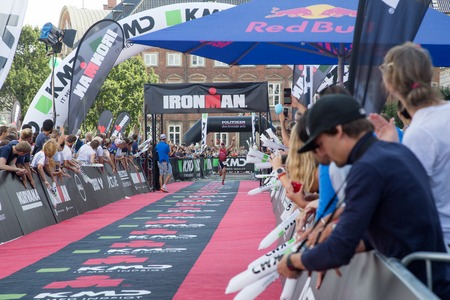 ironman: Copenhagen, Denmark - August 21, 2016: Triathlete Fabio Carvalho just before crossing the finish line as 3rd in mens in 08:07:10 at the KMD Ironman Copenhagen 2016