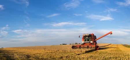 Ramlose, Denmark - August 24, 2016: Panoramic view of a combine harvester at work