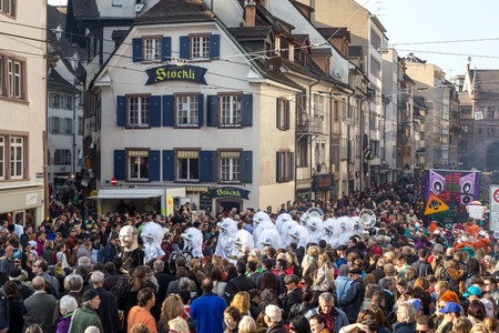 dressed up: Basel, Switzerland - March 10, 2014: Spectators watching the tradtional carnival parade with dressed up people