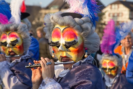 dressed up: Basel, Switzerland - March 10, 2014: The tradtional carnival parade with dressed up people Editorial