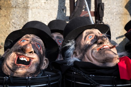 fasnacht: Basel, Switzerland - March 10, 2014: Masks lying around at the tradtional carnival parade