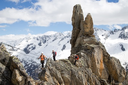Goscheneralp, Switzerland - May 24, 2014: A Group of a climber on a Via Ferrata in Switzerland