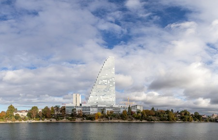 Basel, Switzerland - October 20, 2016: Panoramic view of the Rhine river with the Roche Tower