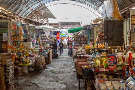 Osh, Kyrgyzstan - October 05, 2014: People shopping inside the Central Market