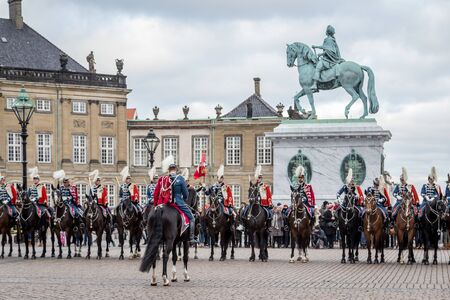 hussar: Copenhagen, Denmark - January 04, 2017: The Guard Hussar Regiment at Amalienborg Palace after having escorted Queen Margrethe in her 24-carat golden coachfrom Christiansborg Palace