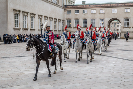escorting: Copenhagen, Denmark - January 04, 2017: The Guard Hussar Regiment preparing for escorting Queen Margrethe in a 24-carat golden coach from Christiansborg Palace to Amalienborg Palace