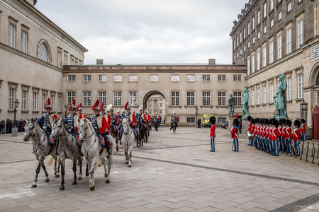 escorting: Copenhagen, Denmark - January 04, 2017: The Guard Hussar Regiment and Royal Guards preparing for escorting Queen Margrethe in a 24-carat golden coach from Christiansborg Palace to Amalienborg Palace
