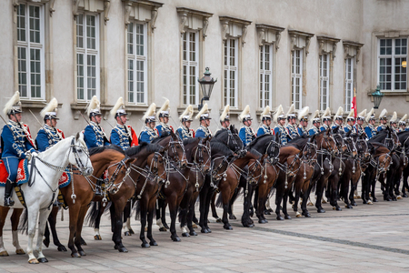 escorting: Copenhagen, Denmark - January 04, 2017: The Guard Hussar Regiment awaiting Queen Margrethe in her 24-carat golden coach at Christiansborg Palace