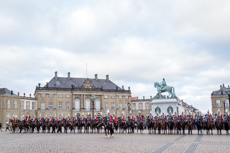 escorting: Copenhagen, Denmark - January 04, 2017: The Guard Hussar Regiment at Amalienborg Palace after having escorted Queen Margrethe in her 24-carat golden coachfrom Christiansborg Palace