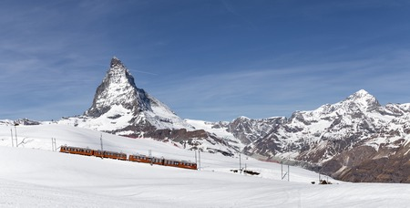 Red Train in front of Matterhorn Editorial