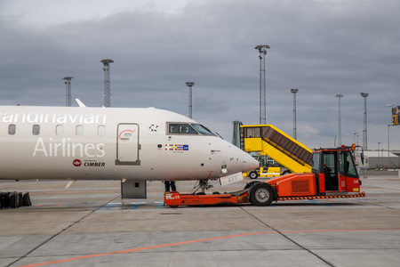 Airport pushback truck with aircraft