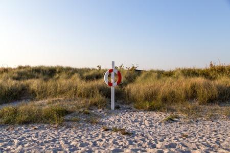 Lifebuoy on sand beach