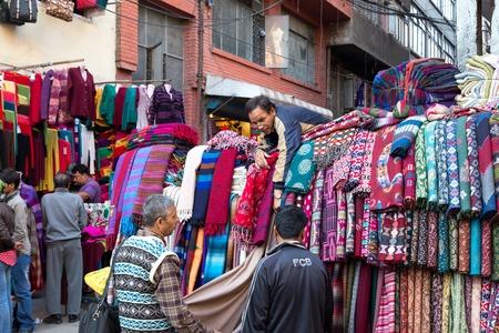 Scarf seller on the market in Kathmandu, Nepal