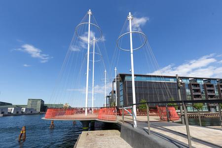 Copenhagen, Denmark - May 23, 2018: The modern Circle Bridge, a pedestrian bridge in the harbour area