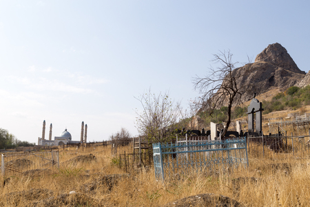 Osh, Kyrgyzstan - October 05, 2014: A traditional muslim cemetery at the foot of Solomons Hill