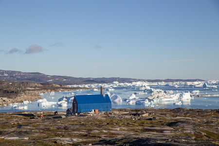 The local waste incineration plant. Rodebay, also known as Oqaatsut is a fishing settlement north of Ilulissat.