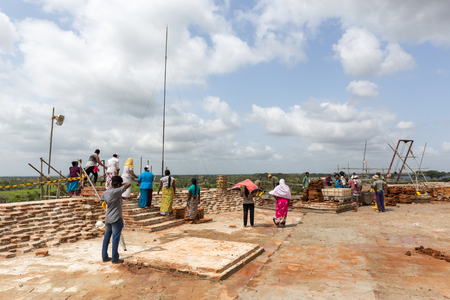 Anuradhapura, Sri Lanka - August 21, 2018: People working on top of Sandahiru Seya, the contruction sote a new stupa.