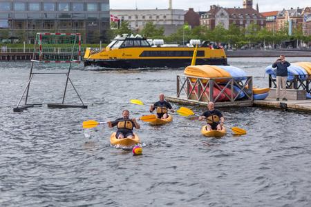 Copenhagen, Denmark - June 20, 2017: Group f men playing kayak polo in Copenhagen harbor