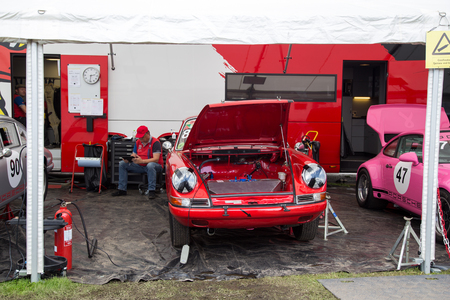 Copenhagen, Denmark -  August 6, 2017: A red Porsche 911 with open engine hood exhibited at the Historic Grand Prix 2017. Editorial