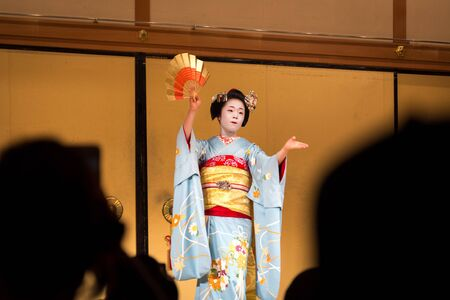 Kyoto, Japan - December 12, 2014: A dancing geisha at a show in famous Gion district.