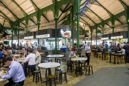 Singapore, Singapore - February 02, 2015: People enjoying food at the Lau Pa Sat foodcourt.