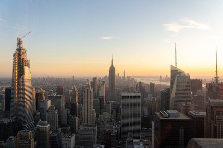 NYC, USA - September 21, 2019: NYC skyline with the Empire State Building in the foreground seen from top of the Rockefeller Center