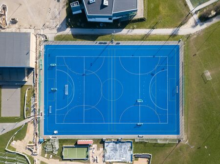 Valby, Denmark - March 22, 2020: Top down aerial drone view of a blue soccer field. 版權商用圖片