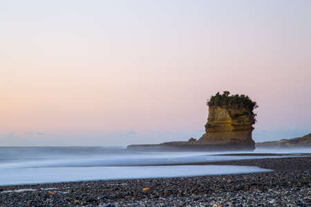 View of Punakaiki beach with special rock formation during sunset time.