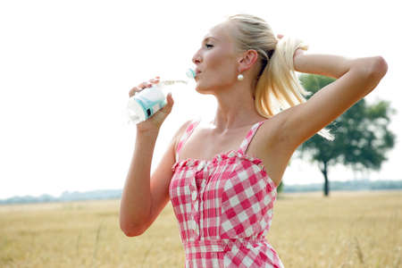 young woman with bottle of water photo