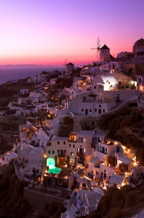 Sunset at world famous view point in oia, santorini, greece photo