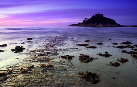 Causway leading to st michaels mount engulfed in rising tide Stock Photo