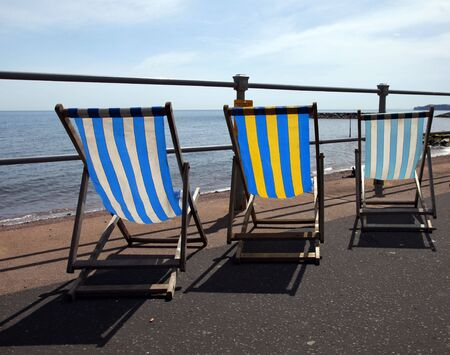 Deck chairs along sidmouth sea front Stock Photo