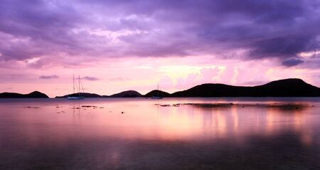 Sunset in Thailand over rawai bay in phuket Stock Photo