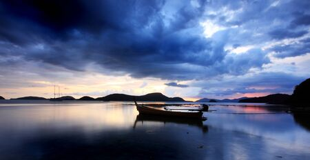Sunset in Thailand over rawai bay in phuket photo