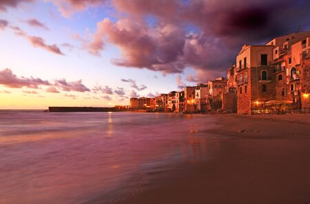 Sunset over cefalu beach Stock Photo