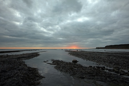 Grey skies over kimmeridge bay in dorset photo