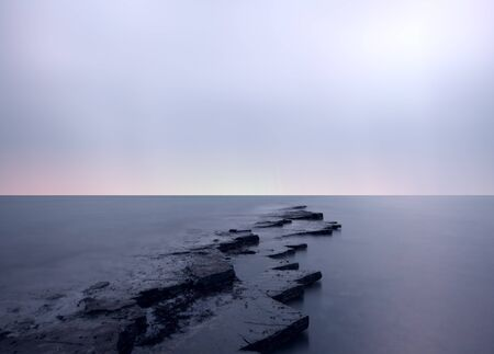 Ghostly skies at kimmeridge bay photo
