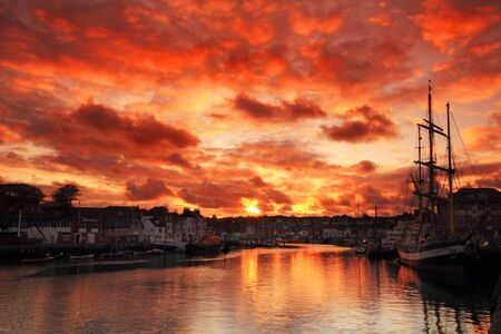 Weymouth harbour, Dorset England, sunset, ship
