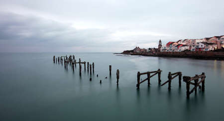 Winter skies over the Old Pier in Swanage bay